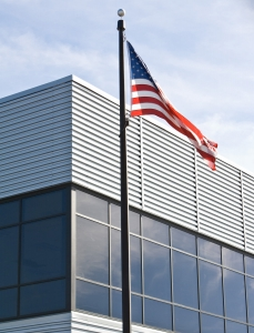 commercial glass windows and an american flag