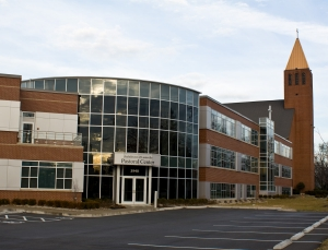 commercial glass doors, glass windows, and a glass facade