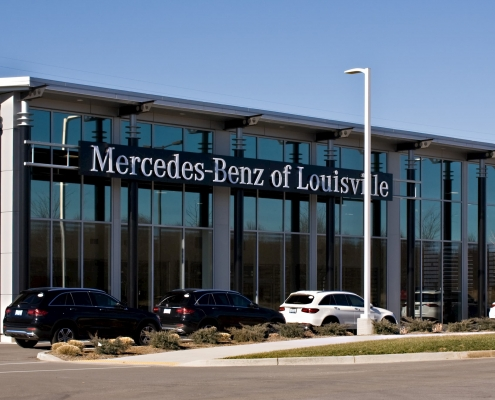 a glass storefront on a car dealership