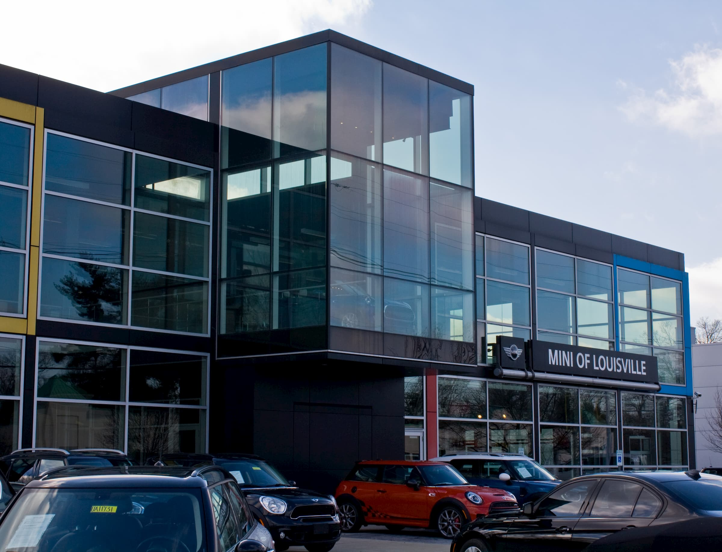 Glass windows and a glass facade on a car dealership