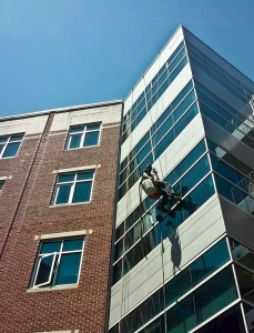 Cleaning windows on a tall building
